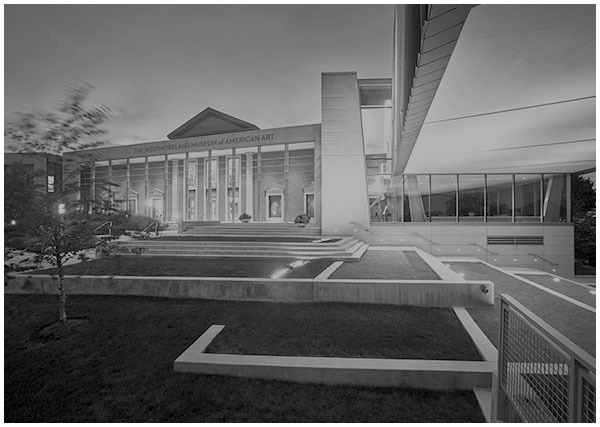 View of The Westmoreland Museum of American Art rear terrace with native plantings and architectural cantilever by Ennead