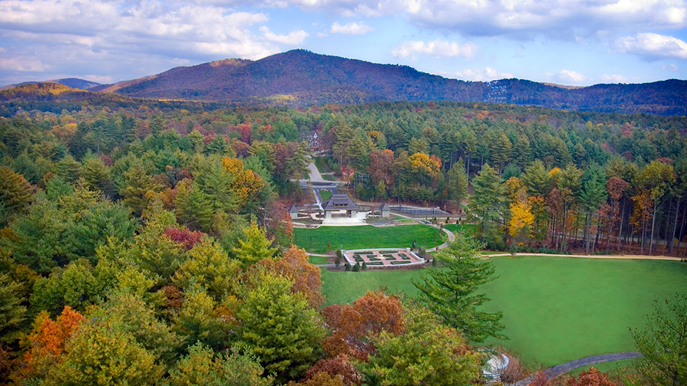 aerial view of the central great lawn and pavillion at the ramble biltmore forest neighborhood in asheville with fall colors and mountains