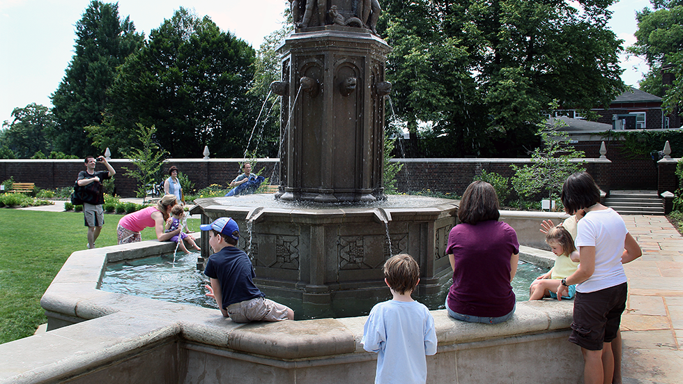 kids playing in historic fountain