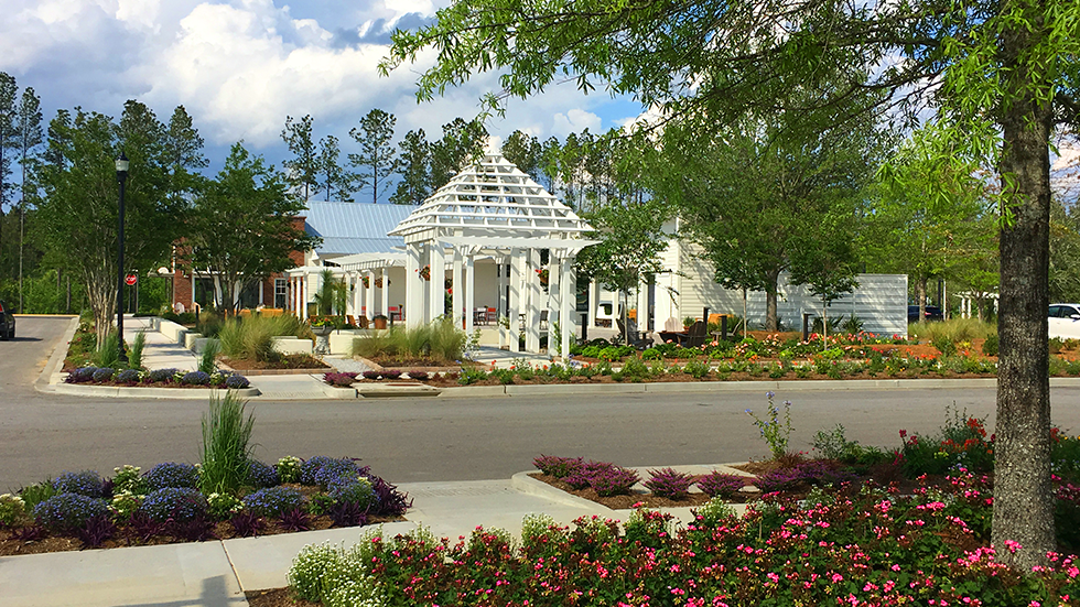 flower gardens and lattice structures at the corner house in summers corner south carolina