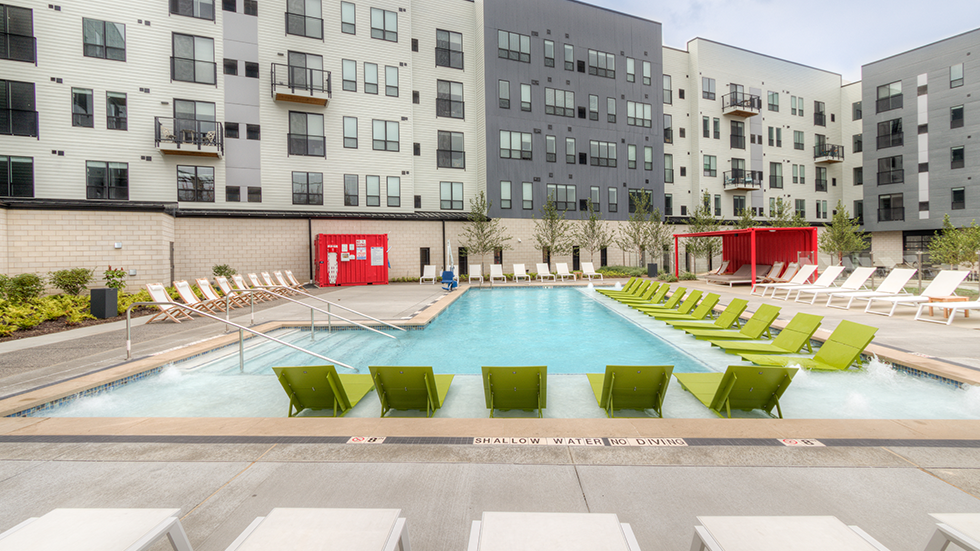 Arsenal Terminal Apartments, Arsenal 201, view of pool area with wet deck loungers and bubblers